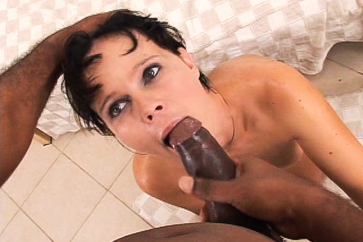 Short haired slut receives a big black cock and mouthful of cum